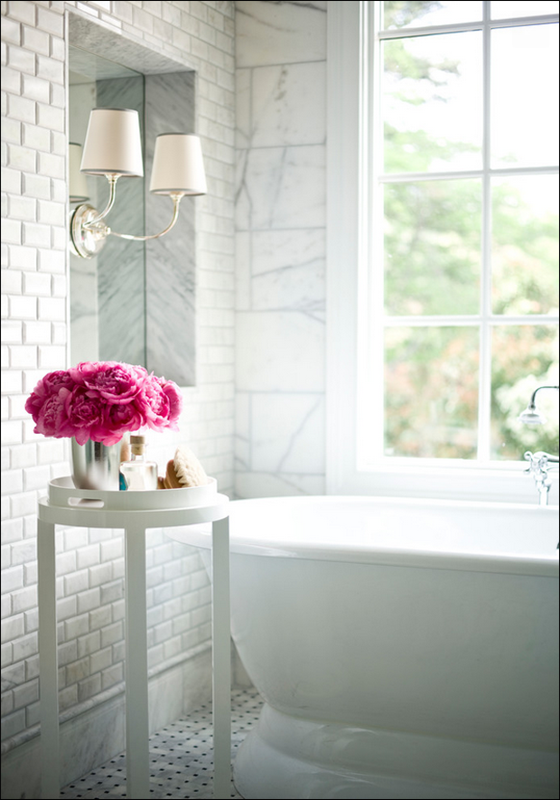 white-bathroom-pink-flowers-and-cast-iron-tub