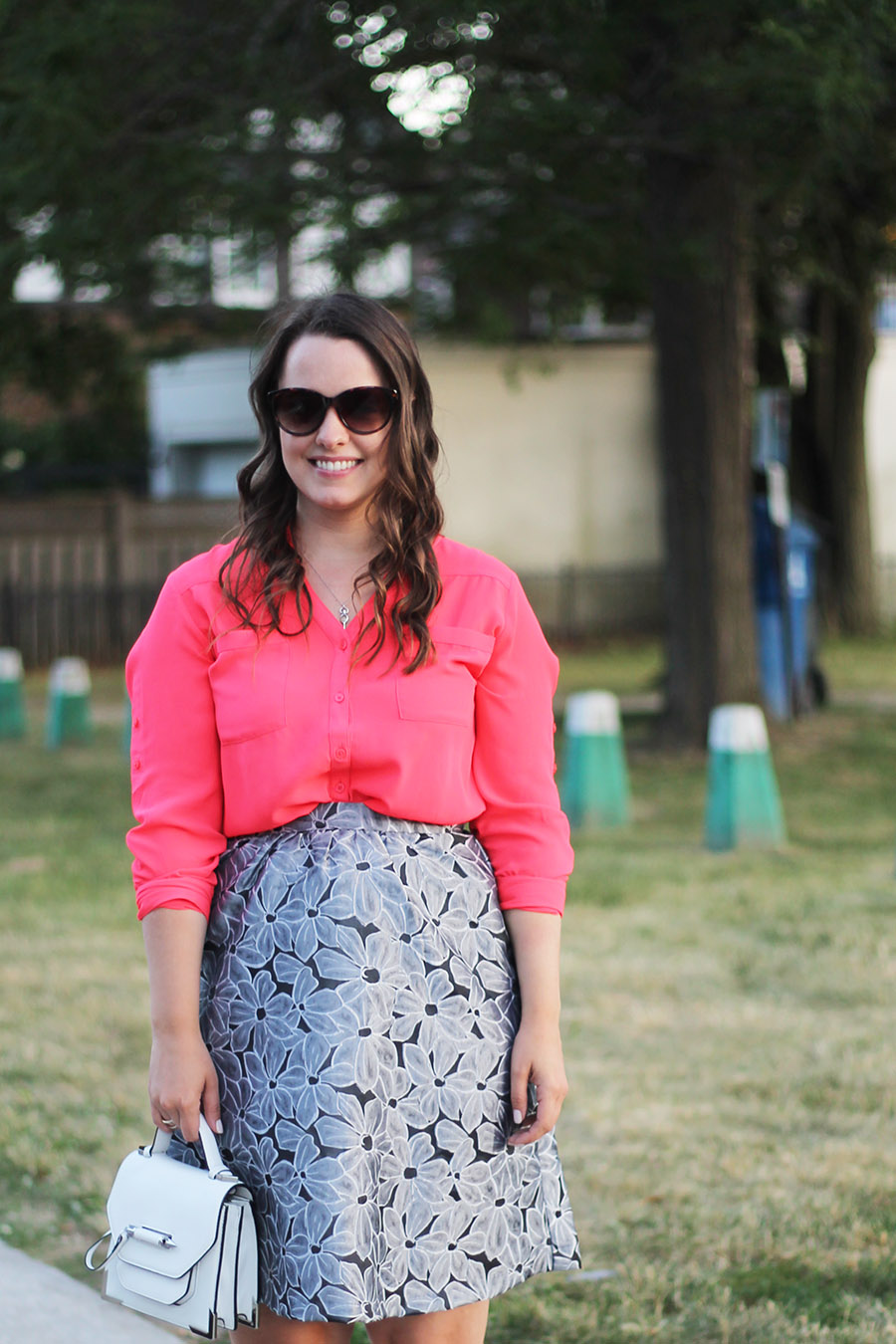 bright-coral-pink-blouse-and-silver-floral-skirt